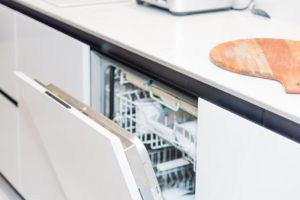 Image of a white integrated kitchen appliance, perfect for small kitchens.