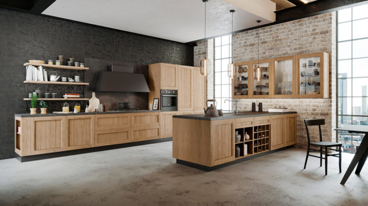Image of the Frida classic kitchen design with an industrial style, featuring wooden kitchen units, brick walls, and black worktops.
